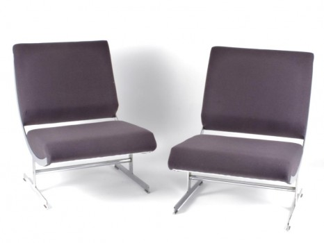 A pair of low chairs