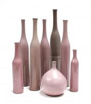 9 pink ceramic vases and bottles